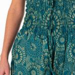 Grønn harembukse med blomstrete motiv for yoga